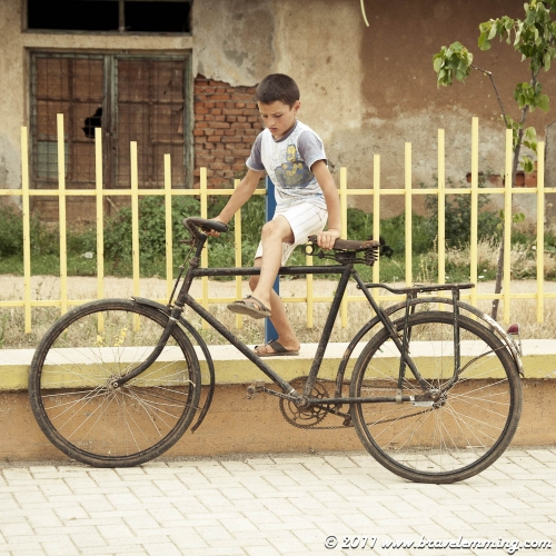 Young boy with an old bike