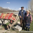 A couple selling apples by the road