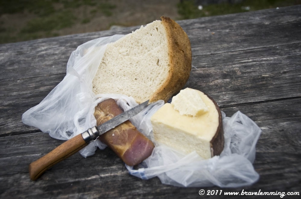 5 degrees outiside : Eating mountain cheese with local ham and bread at 2000m :-)