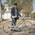 Romanian man with his purple bike
