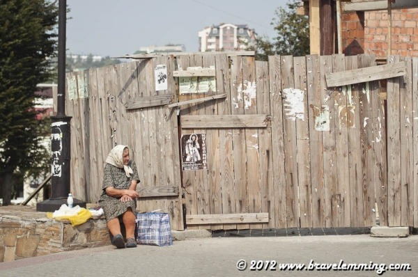 Babushka selling cheese by the road