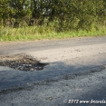 One of the many pothole of Ukrainian roads... we got use to it after a while ;-)