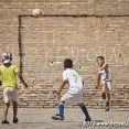 Kids playing footbal in the streets of Bukhara